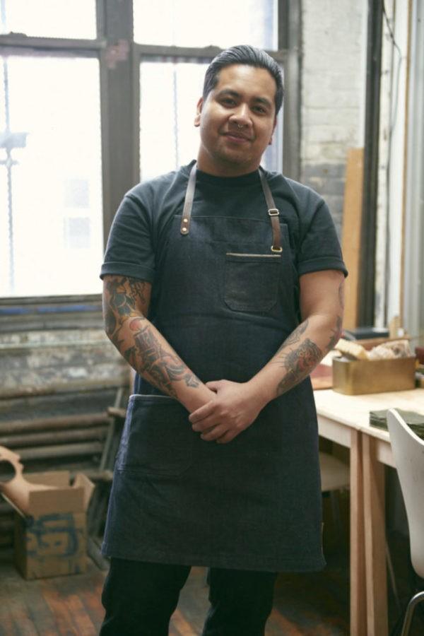 A man's portrait with a chef's dress